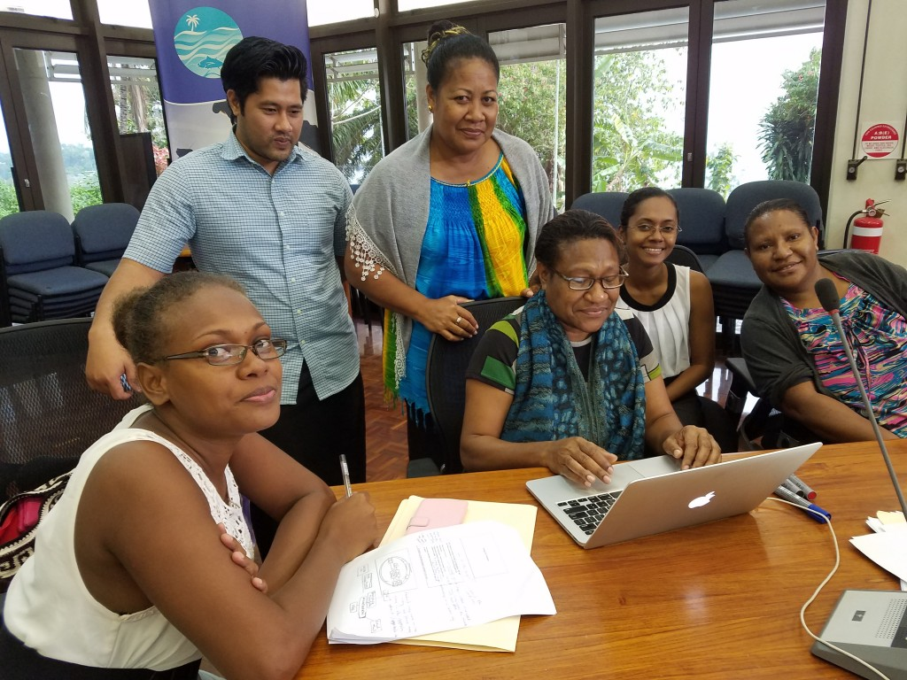 Participants from Papua New Guinea, Samoa and the Solomon Islands work on tracing their tuna value chains